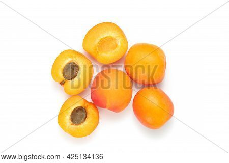 Group Of Apricots And Sliced Apricots Isolated At The White Background Top View