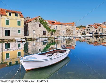 Old Historic Houses In Vrboska Village, Hvar Island, Dalmatia, Croatia, Europe. Fisherman Boat With