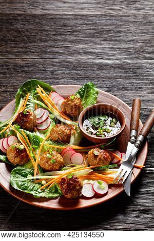 Vietnamese Banh Mi Salad With Pork Meatballs, Carrot, Cucumber, And Radish Served On Romaine Lettuce