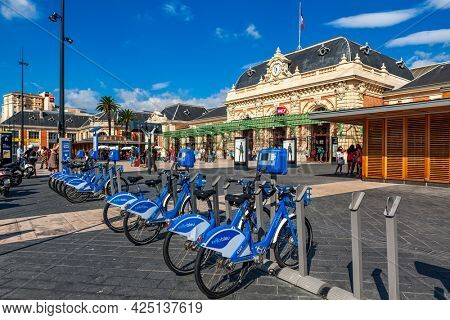 NICE, FRANCE - AUGUST 23, 2014: Bicycles for rent on the square in front of central railway station of Nice - famous tourist resort on French Riviera and one of the most visited cities in France.