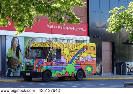 Ottawa, Ontario, Canada - June 9, 2021: A Canada Post Delivery Van Painted With A Colourful \