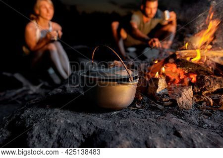 Close Up Shot Of A Cauldron. Cooking Dinner In Field Conditions, Boiling Pot At The Campfire. Outdoo