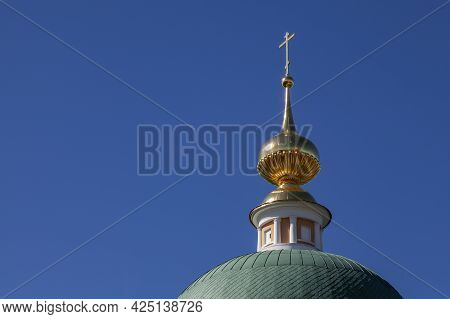 Picturesque Dome Of The Orthodox Church With A Gilded Cross.