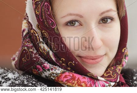 Closeup Cozy Winter Portrait With Snowflakes Of Smiling Pretty Young Woman In Russian Folk Patterned