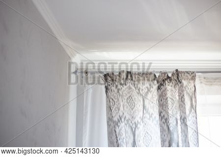 Gray Curtains Hang From Curtain Rings In The Bedroom. Creating Home Comfort With Decor.