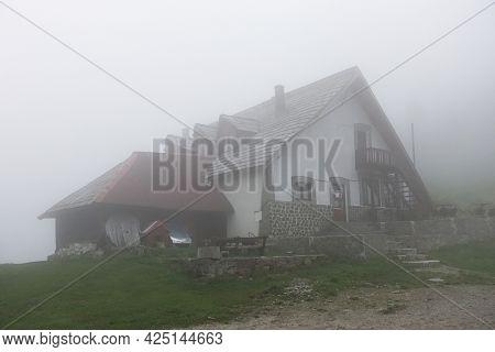 Cozia Chalet in Cozia Mountains, Carpathians, Romania, Europe - rainy and foggy weather