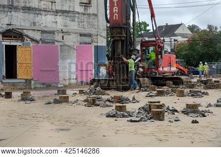 New Orleans, La - June 22: Worker Steadies Piling For Industrial Pile Driver At Uptown Construction