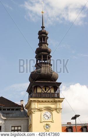 The Tower Of The Old Town Hall In Ostrava On Masaryk Square In Czech Republic. Blue Sky With White C