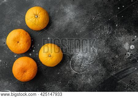 Organic Clementine Or Tangerine Set, On Black Dark Stone Table Background, Top View Flat Lay, With C