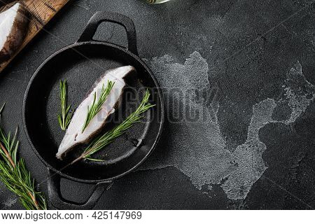Raw Halibut Saltwater Fish Steak Set, With Ingredients And Rosemary Herbs, On Black Dark Stone Table