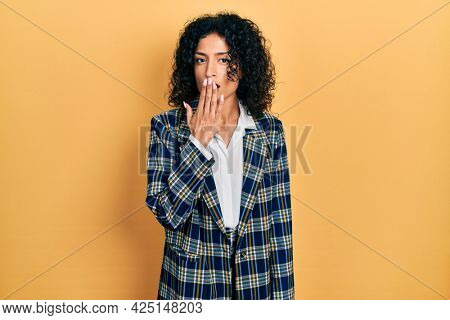 Young latin girl wearing business clothes bored yawning tired covering mouth with hand. restless and sleepiness.