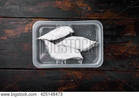 Frozen Halibut Pack  Set, On Old Dark  Wooden Table Background, Top View Flat Lay, With Copy Space F