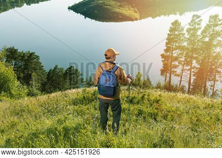 Tourist Man Traveller Hiking In Nature At Sunrise. Hiking In The Mountains.