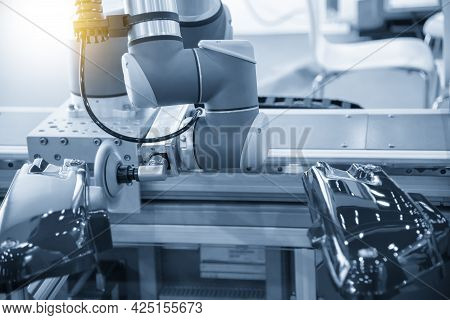 The Robotic Arm Polishing The Automotive Painting Parts .the Hi-technology Automotive Parts Painting