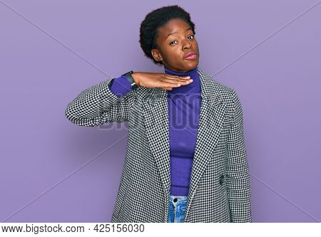 Young african american girl wearing casual clothes cutting throat with hand as knife, threaten aggression with furious violence
