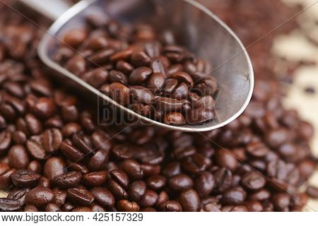 Coffee Beans Texture Or Coffee Beans Background. Brown Roasted Coffee Beans. Closeup Shot Of Coffee