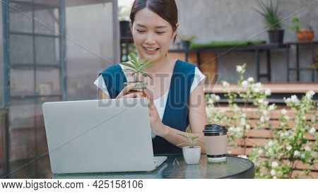 Asian Beautiful Lifestyle Young Woman Talk Selling Small Tree And Cactus Online By Laptop Computer S