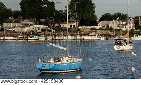 NORWALK, CT, USA - JUNE, 25, 2021: Evening lighs on boats and view from Veterans Park