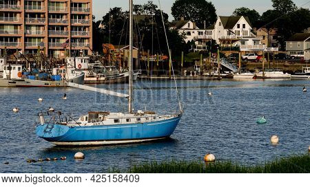 NORWALK, CT, USA - JUNE, 25, 2021: Evening lights on boats and view from Veterans Park