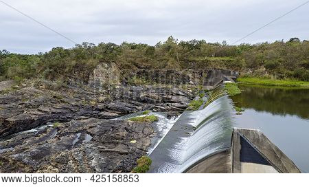 Aerial Of Rocks Downstream Of A Dam Wall With Water Flowing Over Dumbleton Weir Mackay Australia