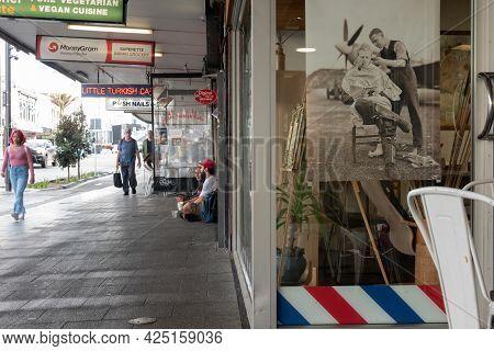 Auckland New Zealand - June 19 2021;karangahape Road Street Scene Of Barber Shop Window And People U