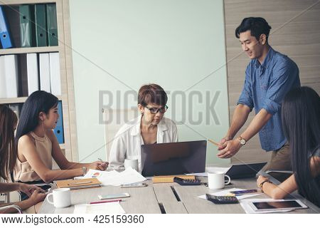 Group Of Business People Meeting In Conference Room. Asian Businessman Speech, Present Teamwork Part