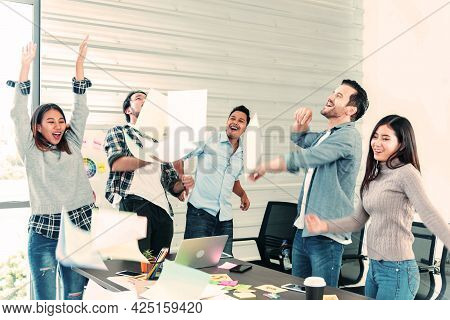 Group Of Business People Finish Job Done Throwing Paper Work And Dance With Happiness. Diversity Peo
