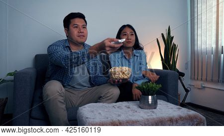 Asian Couples Watch Movies On Tv On Weekends At Night.