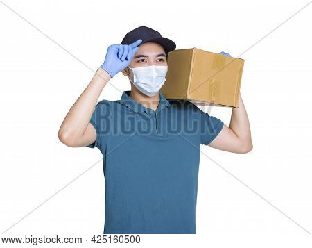 Young Couriers Wear Medical Masks Before Work During The Covid-19 Epidemic. The Package Is Carried O