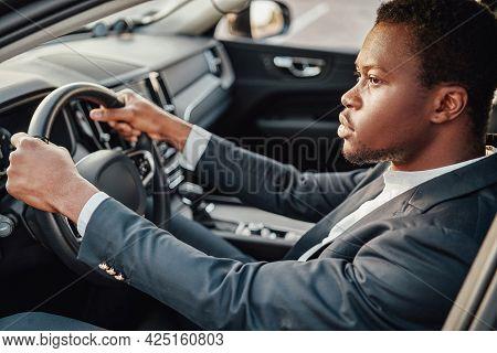 Businessperson Of African Descent Sitting Inside Car