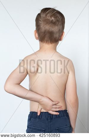 A Little Boy With A Special Orthopedic Posture Corrector On The Back To Adjust, Align The Back, Post