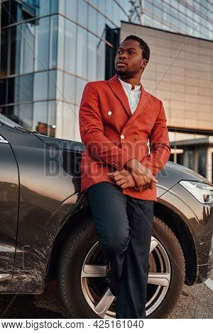 Confident Black Businessperson Posing Leaning His Car