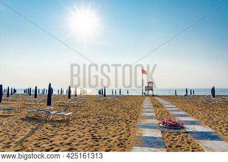 Beach At The Adriatic Sea Coastline In Italy, Europe During Summer. Lots Of Parasol Beach Umbrellas