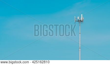 Telecommunication Tower With Clear Blue Sky Background. The Antenna On Blue Sky. Radio And Satellite