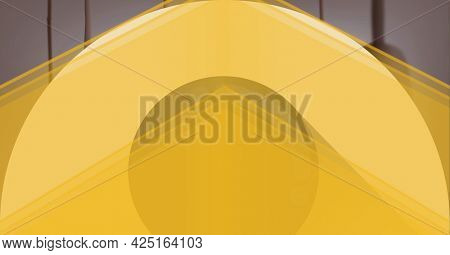 Composition of layered translucent yellow shapes, on grey background. energy, movement and light concept, digitally generated image.