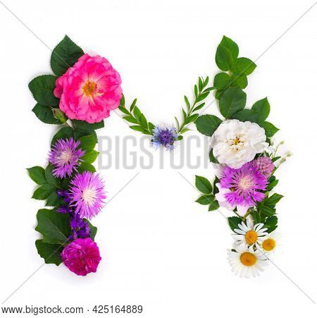 Floral summer font. Concept alphabet design, letter M. Seasonal decorative beautiful type mades of different multi-colored blooming flowers and grass. Natural summertime print
