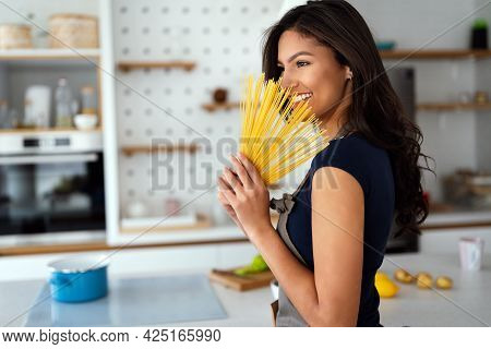 Beautiful Girl Is Going To Cook Pasta. Healthy Lifestyle, Food People Concept