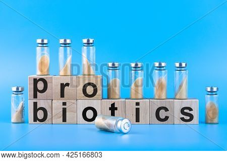 Vials, Ampoules With Dry Probiotic, Bifidobacteria, With Probiotic Powder Inside On A Blue Backgroun