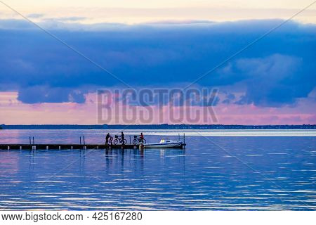Seascape At Evening With Boat Tied To Wooden Pier. Baltic Sea, Puck Bay In Poland With Hel Peninsula