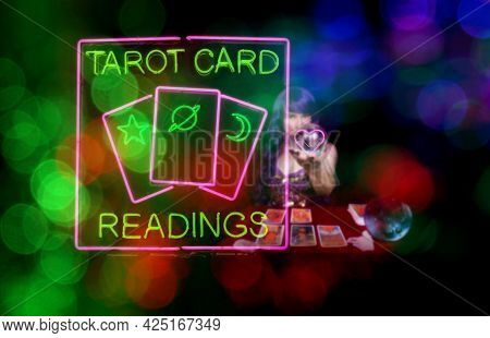 Tarot Card Readings Sign With Psychic Card Reader In Background