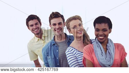 Composition of network of digital icons and smiling group of friends. global digital interface, technology and networking concept digitally generated image.