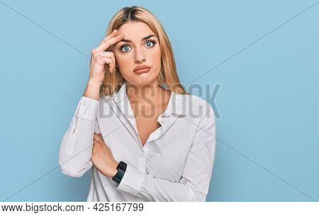 Young caucasian woman wearing casual clothes worried and stressed about a problem with hand on forehead, nervous and anxious for crisis