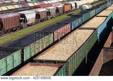 Coal Cars, Wood Chips And Sawdust On The Train. Global Warming. Energy Production.