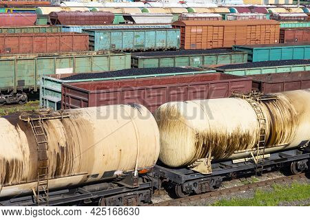 Freight Train With Oil Tanks On The Railroad. There Is Oil In The Cars. Corner Wagons Railway Logist