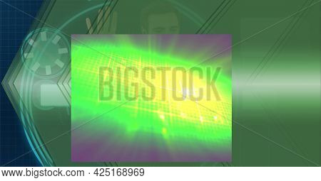 Composition of glowing green light over digital interface and man using computer. global communication and digital interface technology concept digitally generated image.