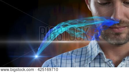 Composition of digital blue light trails over businessman. global business, digital interface, technology and networking concept digitally generated image.