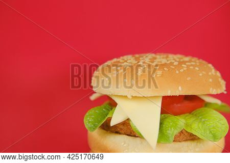 Chicken Burger Close-up On A Bright Red Background.hamburger Day Holiday.fast Food. Delicious Fresh