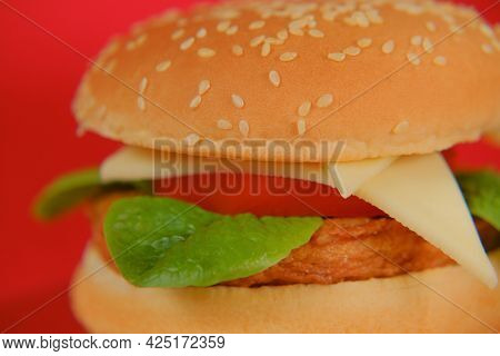 Hamburger.chicken Burger On A Bright Red Background.hamburger Day Holiday.fast Food. Delicious Fresh