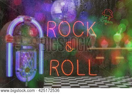 Jukebox In Bar With Neon Signs - Rock And Roll