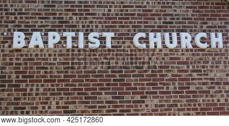 Brick Wall With Baptist Church Sign In Rural Texas
